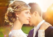 35406585 - young wedding couple enjoying romantic moments outside on a summer meadow